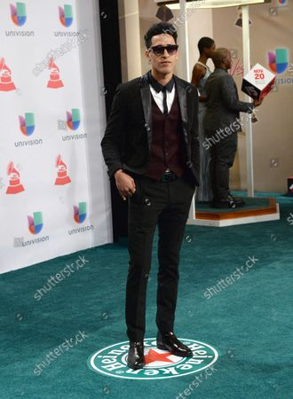 Musician LL Radio arrives for the 15th annual Latin Grammy Awards at the MGM Grand Garden Arena in Las Vegas, Nevada on November 20, 2014.