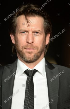 """Stock Photo of American actor Andrew Tarbet attends the premiere of """"Exodus: Gods And Kings"""" world premiere at Odeon, Leicester Square in London on December 3, 2014."""