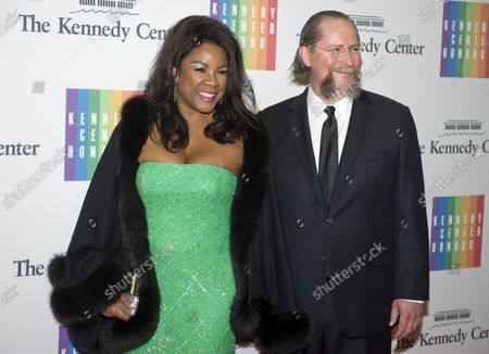 Denyce Graves and Dr. Robert Montgomery arrive for the formal Artist's Dinner honoring the recipients of the 2014 Kennedy Center Honors hosted by United States Secretary of State John F. Kerry at the U.S. Department of State in Washington, D.C. on Saturday, December 6, 2014. The 2014 honorees are: singer Al Green, actor and filmmaker Tom Hanks, ballerina Patricia McBride, singer-songwriter Sting, and comedienne Lily Tomlin.