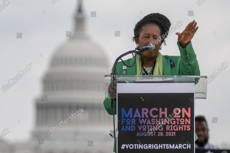 """Rep. Shiela Jackson Lee, D-TX, speaks on the National Mall during the """"March on Washington"""" on the 58th anniversary of the Rev. Martin Luther King Jr.'s """"I Have a Dream"""" speech, in Washington, DC on Saturday, August 28, 2021. Voting rights advocates are demanding federal legislation to protect and expand access to the ballot."""