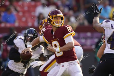Washington Football Team quarterback Kyle Allen (8) looks to pass the ball down field against the Baltimore Ravens during the first half of a preseason NFL football game, in Landover, Md
