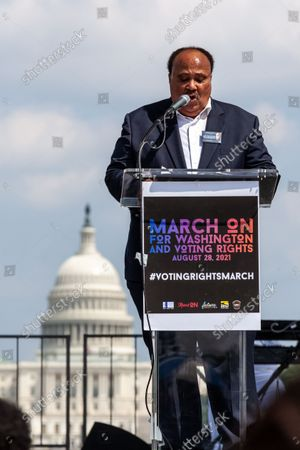 Stock Photo of Martin Luther King III speaks during the flagship event of a nationwide march for voting rights on the 58th anniversary of the March on Washington.  Partcipating individuals and organizations demand an end to the filibuster and passage of the John Lewis Voting Rights Advancement Act and the For the People act to ensure federal protection of the right to vote.  The event is sponsored by the Drum Major Institute, March On, SEIU, National Action Network, and Future Coalition, and has more than 225 partner organizations.