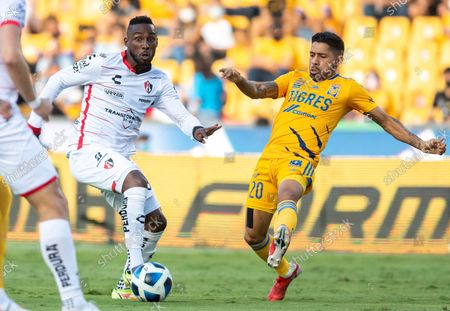 Javier Aquino (R) from Tigres disputes the ball with Julian Quinones from Atlas, during a match for the 2021 Opening Tournament of Mexican professional soccer between Tigres and Atlas at the University Stadium in Monterrey, Mexico, 28 August 2021.