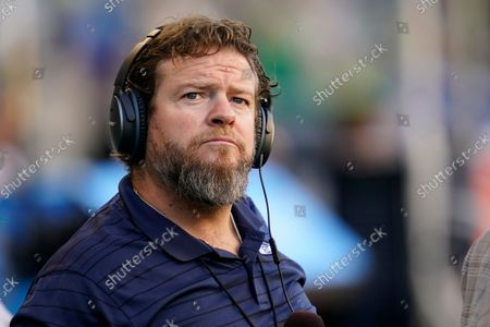 Stock Image of Seattle Seahawks general manager John Schneider wears headphones on the field before an NFL football preseason game against the Los Angeles Chargers, in Seattle