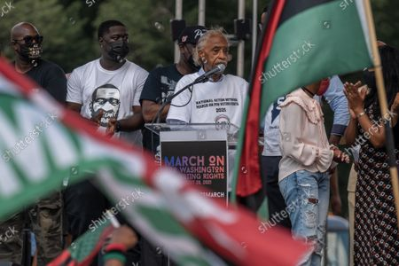 """Rev. Al Sharpton speaks on the National Mall during the """"March on Washington"""" on the 58th anniversary of the Rev. Martin Luther King Jr.'s """"I Have a Dream"""" speech, in Washington, DC on Saturday, August 28, 2021. Voting rights advocates are demanding federal legislation to protect and expand access to the ballot."""