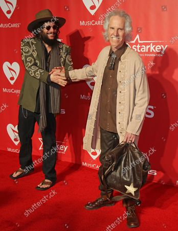 Don Was (L) and John Densmore attend the MusiCares Person of the Year gala honoring singer and songwriter Bob Dylan at the Los Angeles Convention Center in Los Angeles on February 6, 2015.