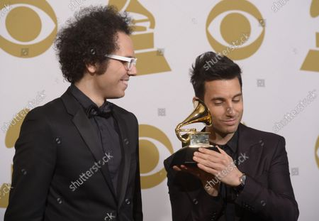 """Musicians Ian Axel,left, and Chad Vaccarino, winners of Best Pop Duo/Group Performance for """"Say Something, """" pose backstage during the 57th Grammy Awards at Staples Center in Los Angeles on February 8, 2015"""