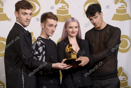 """(L-R) Musicians Jack Patterson, Luke Patterson, Grace Chatto, and Milan Neil Amin-Smith of musical group """"Clean Bandit"""" pose backstage with award for  Best Dance Recording for """"Rather Be,"""" during the 57th Grammy Awards at Staples Center in Los Angeles on February 8, 2015"""