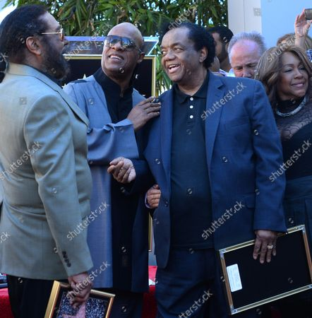 Stevie Wonder (C) mingles with songwriters Eddie Holland (L) and Lamont Dozier and during an unveiling ceremony honoring Eddie Holland, Lamont Dozier and Brian Holland with the 2,543rd star on the Hollywood Walk of Fame in Los Angeles on February 13, 2015.