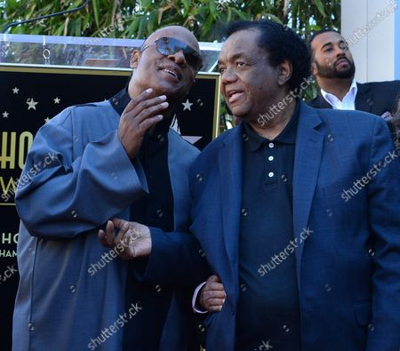 Stevie Wonder (L) mingles with songwriter Lamont Dozier during an unveiling ceremony honoring Eddie Holland, Lamont Dozier and Brian Holland with the 2,543rd star on the Hollywood Walk of Fame in Los Angeles on February 13, 2015.