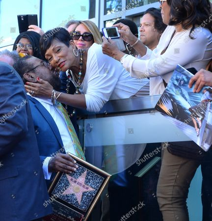 Brian Holland is congratulated during an unveiling ceremony honoring Eddie Holland, Lamont Dozier and Brian Holland with the 2,543rd star on the Hollywood Walk of Fame in Los Angeles on February 13, 2015.