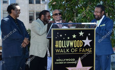 Songwriters Lamont Dozier, Eddie Holland and Brian Holland (L-R) react to comments by Barry Gordy (C) during an unveiling ceremony honoring them with the 2,543rd star on the Hollywood Walk of Fame in Los Angeles on February 13, 2015.