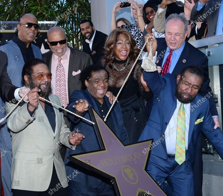 Stock Photo of Songwriters Eddie Holland, Lamont Dozier and Brian Holland (L-R) participate in an unveiling ceremony honoring them with the 2,543rd star on the Hollywood Walk of Fame in Los Angeles on February 13, 2015. Joining them are singer/songwriter Stevie Wonder, record producer Berry Gordy, singer Mary Wilson and Councilman Tom LaBonge (L-R, rear).