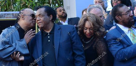 Stevie Wonder, Lamont Dozier , Mary Wilson and Brian Holland mingle during an unveiling ceremony honoring Eddie Holland, Lamont Dozier and Brian Holland with the 2,543rd star on the Hollywood Walk of Fame in Los Angeles on February 13, 2015.