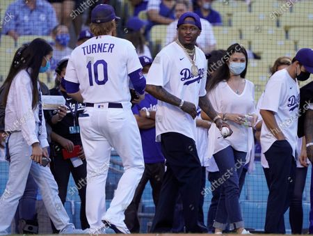 Rapper YG throws the ceremonial first pitch prior to the start of the Colorado Rockies and Los Angeles Dodgers baseball game at Dodger Stadium on August 28, 2021 in Los Angeles, California