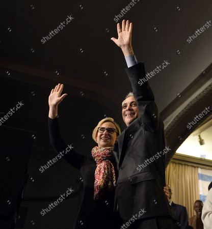 """Stock Image of Chicago Mayor Rahm Emanuel (R) and his wife Amy Rule wave to supporters at a rally at the Plumbers Local Union 130 hall following the mayoral run-off election in Chicago on April 7, 2015. Emanuel defeated opponent Jesus """"Chuy"""" Garcia in the first runoff since Chicago switched to non-partisan elections 20 years ago."""