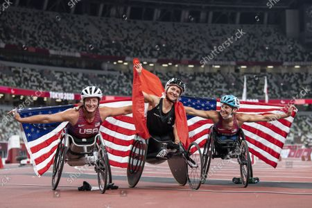 Manuela Schaer (C) of Switzerland poses with Tatyana McFadden (L) of the United States, and Susannah Scaroni of the United States (R) after winning the Women's 800m T54 Final competition at the 2020 Tokyo Summer Paralympics Games at the Olympic Stadium in Tokyo, Japan, 29 August 2021.