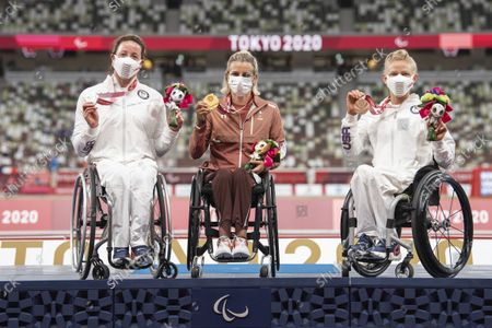 Manuela Schaer, center, of Switzerland celebrates her gold medal with Tatyana McFadden, left, of the United States, and Susannah Scaroni of the United States, right, after winning the Women's 800m T53 Final competition at the 2020 Tokyo Summer Paralympics Games at the Olympic Stadium in Tokyo, Japan, 29 August 2021.