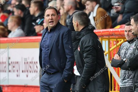 Stock Image of Aberdeen Manager Stephen Glass and Ross County's  Manager Malky Mackay during the Cinch Scottish Premiership match between Aberdeen and Ross County at Pittodrie Stadium, Aberdeen