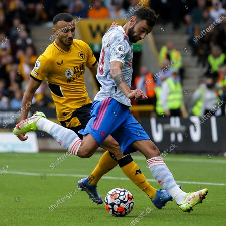 Bruno Fernandes of Manchester United takes on Romain Saiss of Wolverhampton Wanderers