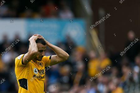 Romain Saiss of Wolverhampton Wanderers cuts a dejected figure