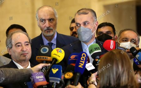 Iranian Foreign Minister Hossein Amir-Abdollahian (2-R) speaks at a press conference with his Syrian counterpart Faisal al-Mekdad (L) and Syrian Deputy Foreign Minister Bashar al-Jaafari (2-L) in Damascus, Syria, 29 August 2021. Amir-Abdollahian arrived in Damascus for talks with Syrian officials a day after attending a regional conference in Baghdad on cooperation and partnership. Iranian newly appointed foreign minister told reporters upon arrival that the two countries 'will work together to face the economic terrorism' referring to international sanctions imposed on the two sides.