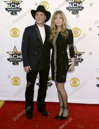 Singer Clint Black , left, and Lisa Hartman Black attend the 50th annual Academy of Country Music Awards held at AT&T Stadium in Arlington, Texas on April 19, 2015.
