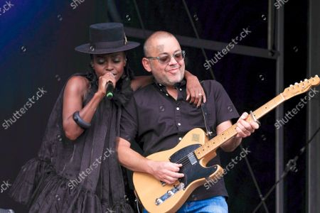 """Shirley Klaris Yonavieve  """"Skye"""" Edwards, singer songwriter and female vocalist with English electronic band Morcheeba, and Ross Godfrey, guitarist performing live on stage at Victorious Festival."""