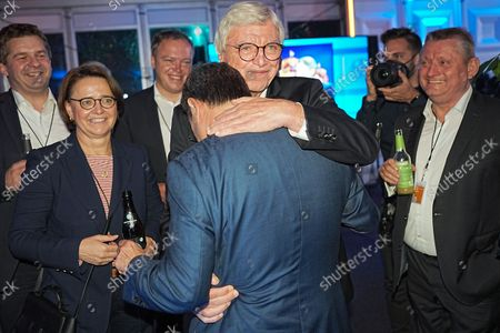 Hessian Prime Minister Volker Bouffier (C) hugs Chancellor candidate of CDU Armin Laschet (C) with supporters and party friends after TV discussion on RTL and ntv in Berlin, Germany, 29 August 2021. Germany elects a new parliament on 26 September 2021.