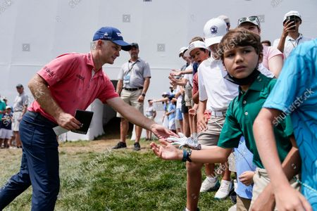 Stock Image of Kevin Streelman gives his glove to a spectator after finishing his round during the final round of the BMW Championship golf tournament, at Caves Valley Golf Club in Owings Mills, Md