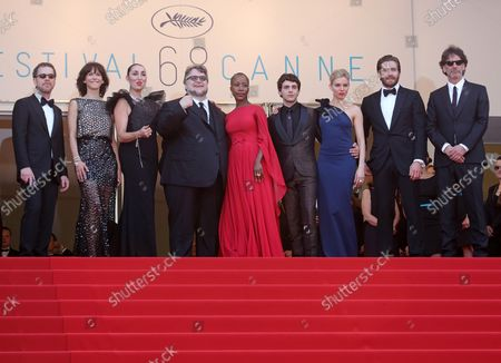 """Jury members Ethan Coen, Sophie Marceau, Rossy de Palma, Guillermo del Toro, Rokia Traore, Xavier Dolan, Sienna Miller, Jake Gyllenhaal and Joel Coen arrive on the steps of the Palais des Festivals before the screening of the film """"La Tete Haute (Standing Tall)"""" during the 68th annual Cannes International Film Festival in Cannes, France on May 13, 2015."""
