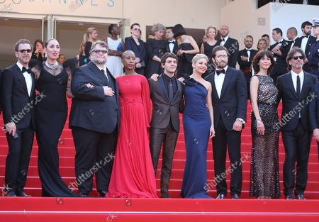 """Jury members Ethan Coen, Rossy de Palma, Guillermo del Toro, Rokia Traore, Xavier Dolan, Sienna Miller, Jake Gyllenhaal, Sophie Marceau and Joel Coen arrive on the steps of the Palais des Festivals before the screening of the film """"La Tete Haute (Standing Tall)"""" during the 68th annual Cannes International Film Festival in Cannes, France on May 13, 2015."""