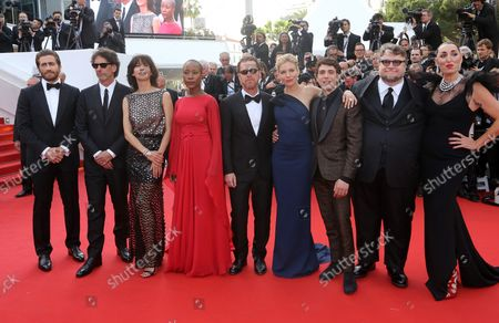 """(From L to R) Jury members Jake Gyllenhaal, Joel Coen, Sophie Marceau, Rokia Traore, Ethan Coen, Sienna Miller, Xavier Dolan, Guillermo Del Toro and Rossy De Palma arrive on the red carpet before the screening of the film """"La Tete Haute (Stand Tall)"""" during the 68th annual Cannes International Film Festival in Cannes, France on May 13, 2015."""