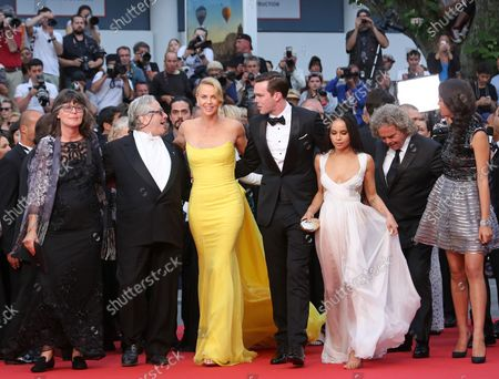"""(From L to R) Sandy Gore, George Miller, Charlize Theron, Nicholas Hoult, Zoe Kravitz, Doug Mitchell and Courtney Eaton arrive on the red carpet before the screening of the film """"Mad Max : Fury Road"""" during the 68th annual Cannes International Film Festival in Cannes, France on May 14, 2015."""