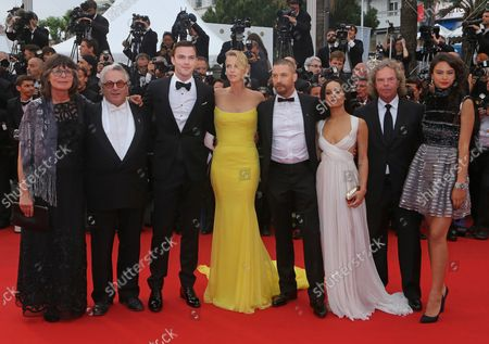 """(From L to R) Sandy Gore, George Miller, Nicholas Hoult, Charlize Theron, Tom Hardy, Zoe Kravitz, Doug Mitchell and Courtney Eaton arrive on the red carpet before the screening of the film """"Mad Max : Fury Road"""" during the 68th annual Cannes International Film Festival in Cannes, France on May 14, 2015."""