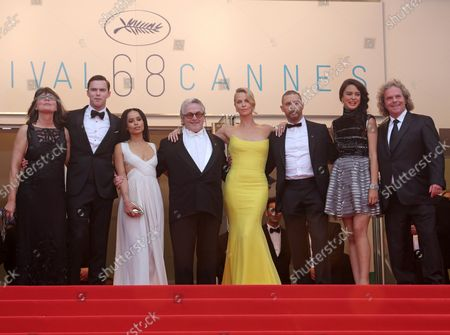 """(From L to R) Margaret Sixel, Nicholas Hoult, Zoe Kravitz, George Miller, Charlize Theron, Tom Hardy, Courtney Eaton and Doug Mitchell arrive on the steps of the Palais des Festivals before the screening of the film """"Mad Max : Fury Road"""" during the 68th annual Cannes International Film Festival in Cannes, France on May 14, 2015."""