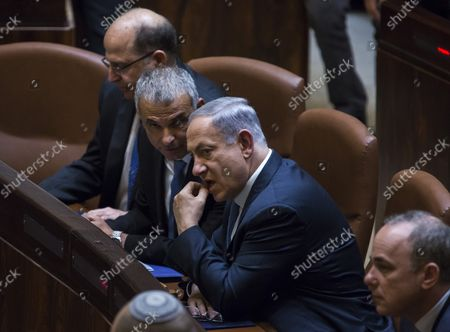 Israeli Prime Minister Benjamin Netanyahu (3L) heads new government as ministers take their place including Defense Minister Moshe Ya'alon (L), and Moshe Kahlon , Housing Minister (2L) as the prime minister fills cabinet posts at the las minute, forming the 34th government of Israel, two months after the mid-March general elections in Jerusalem on May 14, 2015. At right is new Energy Minister Yuval Steinitz.