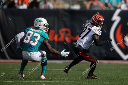 Cincinnati Bengals cornerback Tony Brown (27) defends against Miami Dolphins wide receiver Kirk Merritt (83) during an NFL football game, in Cincinnati