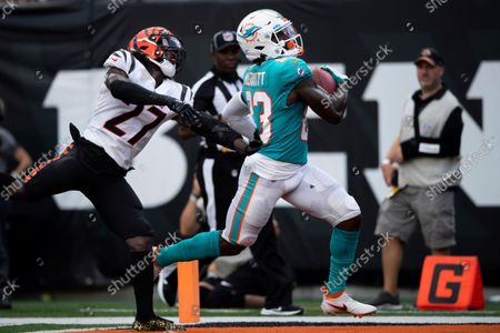 Miami Dolphins wide receiver Kirk Merritt (83) runs by Cincinnati Bengals cornerback Tony Brown (27) for a touchdown during an NFL football game, in Cincinnati