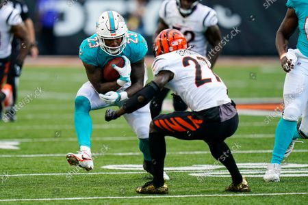 Cincinnati Bengals defensive back Tony Brown (27) tackles Miami Dolphins running back Gerrid Doaks (23) in the second half of an NFL exhibition football game in Cincinnati