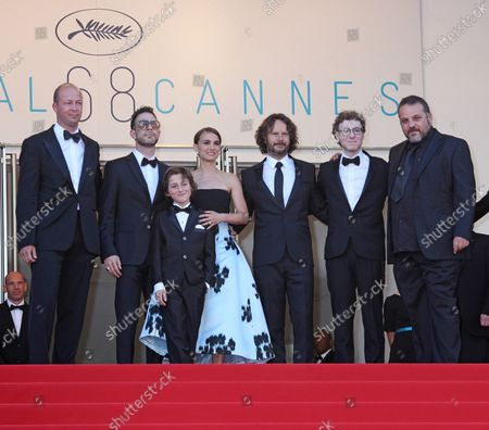 """The team from the film """"A Tale Of Love And Darkness"""", including (from L to R) Amir Tessler, Gilad Kahana, Natalie Portman and Ram Bergman, arrives on the steps of the Palais des Festivals before the screening of the film during the 68th annual Cannes International Film Festival in Cannes, France on May 16, 2015."""