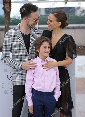 """Gilad Kahana (L), Amir Tessler (C) and Natalie Portman arrive at a photocall for the film """"A Tale of Love and Darkness"""" during the 68th annual Cannes International Film Festival in Cannes, France on May 17, 2015."""