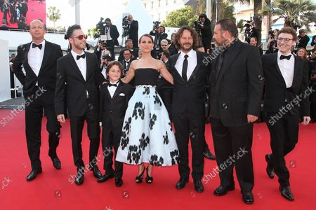"""The team from the film """"A Tale Of Love And Darkness"""", including (from L to R) Amir Tessler, Gilad Kahana, Natalie Portman and Ram Bergman, arrives on the red carpet before the screening of the film during the 68th annual Cannes International Film Festival in Cannes, France on May 16, 2015."""