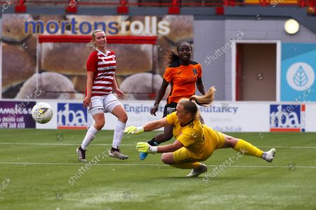 Ode Fulutudilu (#9) of Glasgow City FC with a shot from close range saved by Sarah Rhind (#1) of Hamilton Academical WFC during the Scottish Women's Premier League Cup match between Hamilton Academical FC Women and Glasgow City Women at Fountain of Youth Stadium, Hamilton