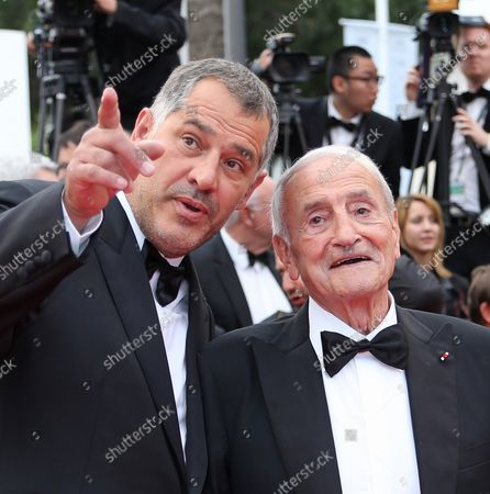 """Luc Jacquet (L) and Claude Lorius arrive on the red carpet before the screening of the film """"Le Glace Et Le Ciel"""" during the 68th annual Cannes International Film Festival in Cannes, France on May 24, 2015."""