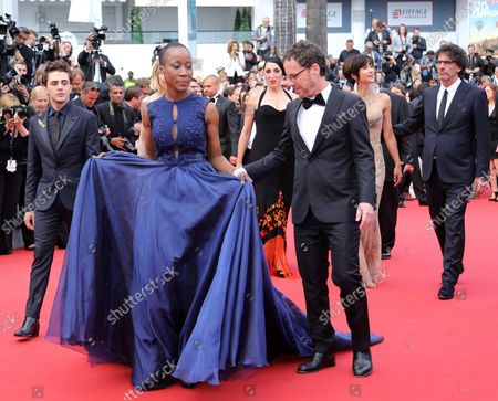 """Stock Photo of Members of the Jury, including Ethan Coen, Jake Gyllenhaal, Rokia Traore, Rossy de Palma, Sienna Miller, Joel Coen, Xavier Dolan, Sophie Marceau and Guillermo del Toro, arrive on the red carpet before the screening of the film """"Le Glace Et Le Ciel"""" during the 68th annual Cannes International Film Festival in Cannes, France on May 24, 2015."""
