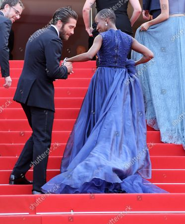"""Jake Gyllenhall (L) and Rokia Traore arrive on the red carpet before the screening of the film """"Le Glace Et Le Ciel"""" during the 68th annual Cannes International Film Festival in Cannes, France on May 24, 2015."""