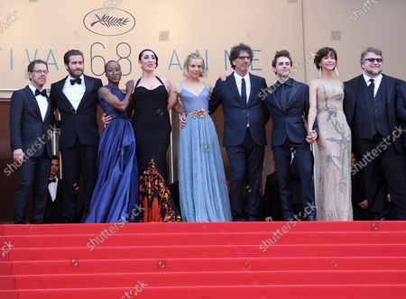 """(From L to R) Ethan Coen, Jake Gyllenhaal, Rokia Traore, Rossy de Palma, Sienna Miller, Joel Coen, Xavier Dolan, Sophie Marceau and Guillermo del Toro arrive on the red carpet before the screening of the film """"Le Glace Et Le Ciel"""" during the 68th annual Cannes International Film Festival in Cannes, France on May 24, 2015."""