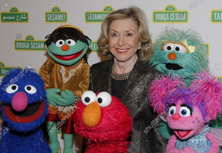Joan Ganz Cooney stands on the red carpet with Elmo and other Sesame Street Muppet's at the Sesame Workshop's 13th Annual Benefit Gala at Cipriani 42nd Street  in New York City on May 27, 2015.