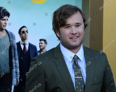 """Cast member Haley Joel Osment attends the premiere of the motion picture comedy """"Entourage"""" at the Regency Village Theatre in the Westwood section of Los Angeles on June 1, 2015. Storyline: Movie star Vincent Chase, together with his boys Eric, Turtle, and Johnny, are back - and back in business with super agent-turned-studio head Ari Gold on a risky project that will serve as Vince's directorial debut."""